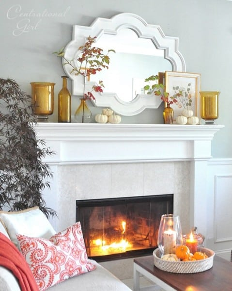 amber bottles and mirror on mantel 479x600 7 simple fall mantles